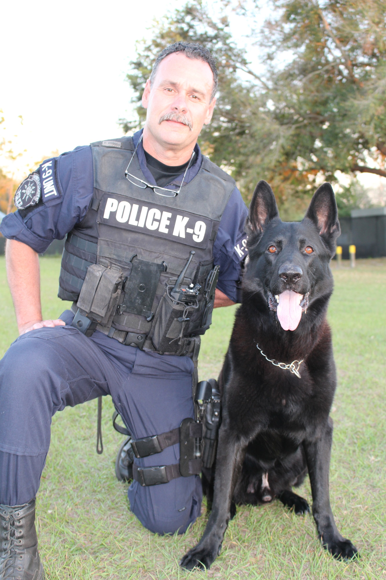 W.G. Police Officer Jeff Doyle Poses With 7 Year Old K 9 Kimber, Who Was  Imported From The Czech Republic. U201cKimber Is Kind Of A Little Practical  Joker.
