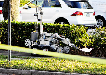 Photo by: Tim Freed - A bomb squad robot was brought in to investigate the scene of a suspicious package at the Rosen Family Center near Rollins College in Winter Park.