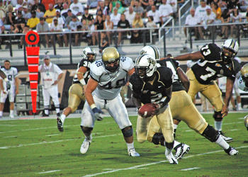 Photo by: Isaac Babcock - Jeff Godfrey led the Knights to a season-opening blowout over Charleston Southern 62-0