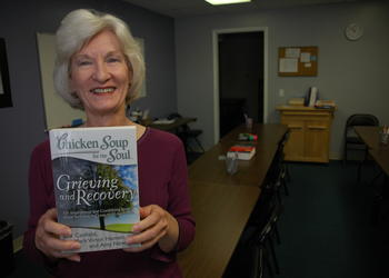 "Photo by: Isaac Babcock - Bettie Wailes tutors college prep classes, but has turned writing into a source of fame. Above, she shows off  ""Grieving and Recovery"", in which her story ""The Secret Shopper"" appears. The author is also an avid runner, compe..."