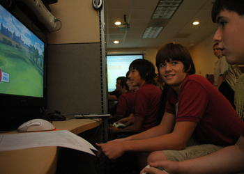 Photo by: Isaac Babcock - Jacob Dunagan, left, and Cody Hurtnagel, 13, test out a golf video game at Electronic Arts Tiburon Studios in Maitland.