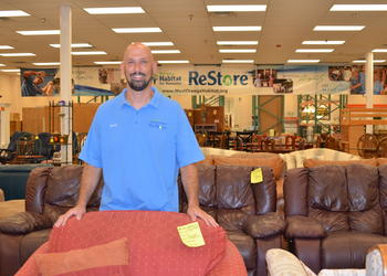 Aaron Vasilko is manager of the Habitat ReStore, which has moved to larger quarters in the Winter Garden Plaza shopping center, behind Taco Bell.