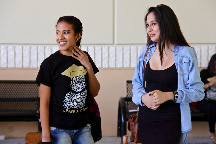 Valeria Moreno, left, and Gisselle Vela watched the antics of their classmates during their last day at school.