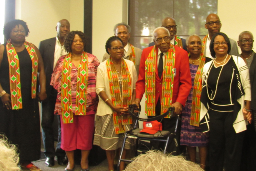 "The ""Hannibal Square Heroes"" and their representatives stand tall at the Winter Park Community Center as they celebrate their contributions to the city."