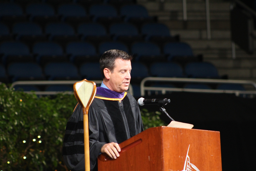 Orange County School Board Chairman Bill Sublette spoke in front of the arena's hundreds of graduating seniors.