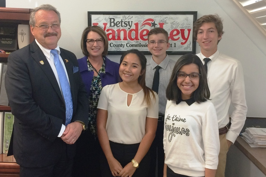 A visit to Orange County District 1 Commissioner Betsy VanderLey allowed the students to learn about their Orange County government. From left: Windermere Mayor Gary Bruhn; VanderLey; Bichgaing Nguyen, West Orange High School; Tho