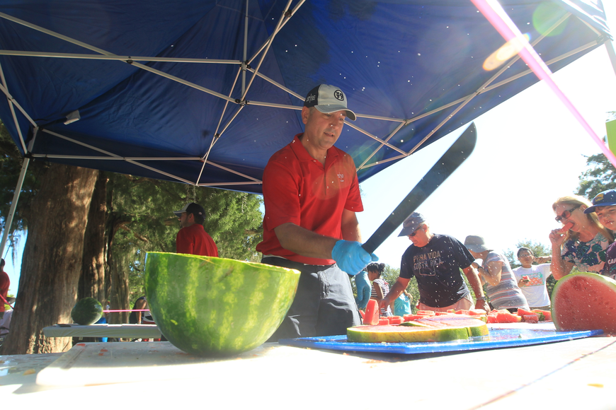 Gregg Pascale chops up juicy watermelons during Winter Park's Fourth of July Celebration.