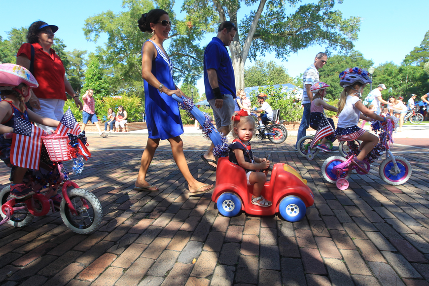 Children stroll down Park Avenue as they participate in a patriotic bicycle parade.