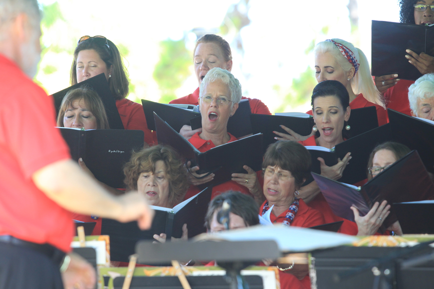 Members of the Bach Festival Choir sing along with the Bach Festival Brass Band during a performance.