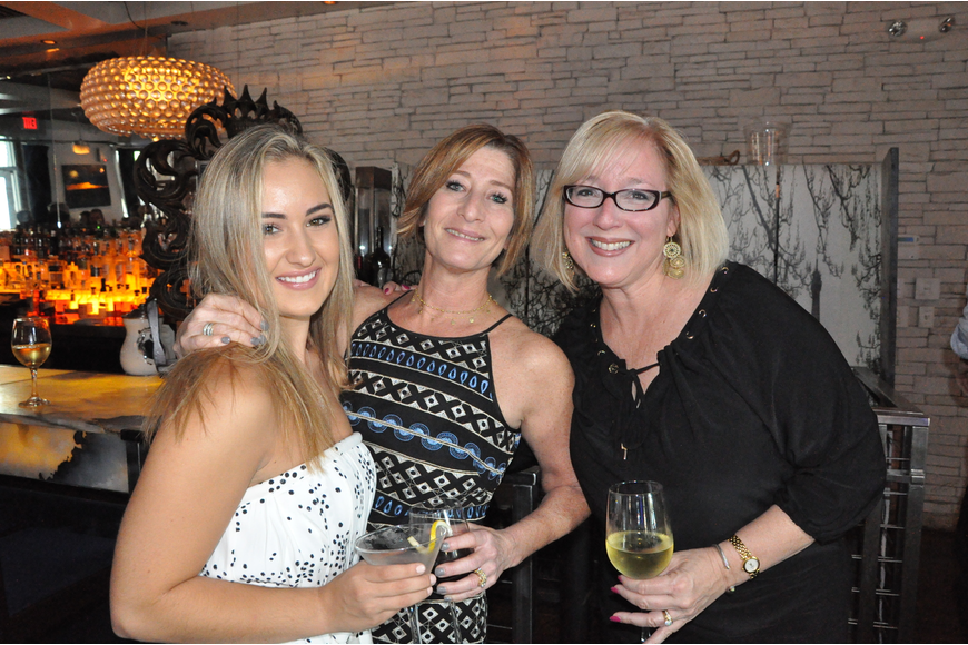 Taylor Gagliano, Erika Beneev and Joanne Stake mingled at the 20th anniversary party.