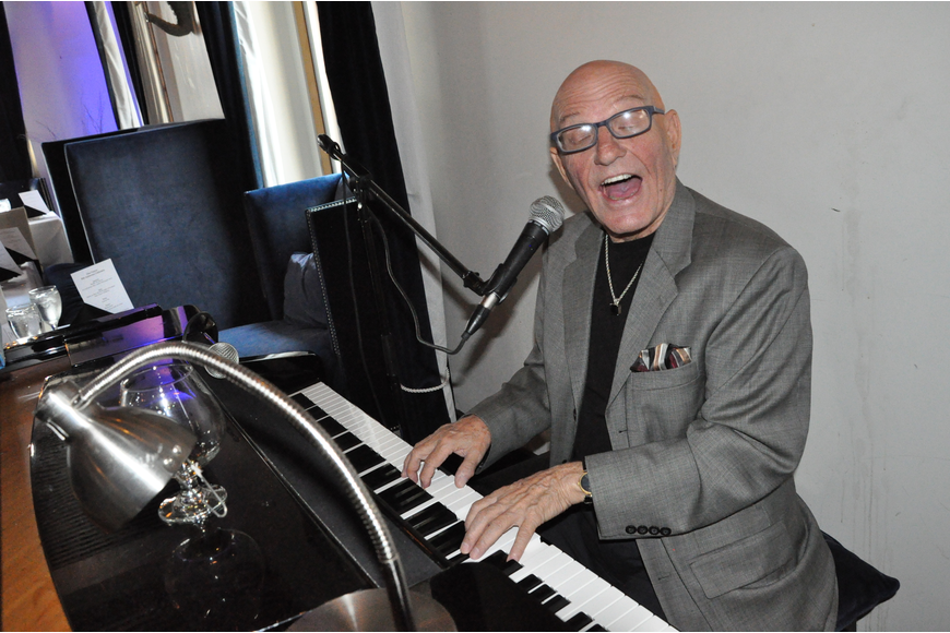 Pianist and singer Michael Lamy provided the music during the celebration.