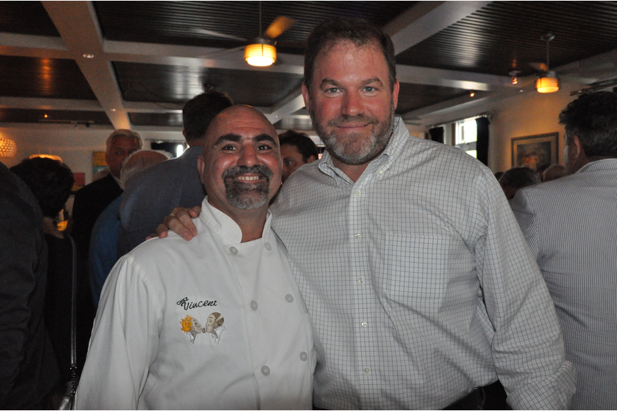 Chef Vincent Gagliano and Winter Park Mayor Steve Leary posed for a photo at the Chez Vincent 20-year anniversary party.