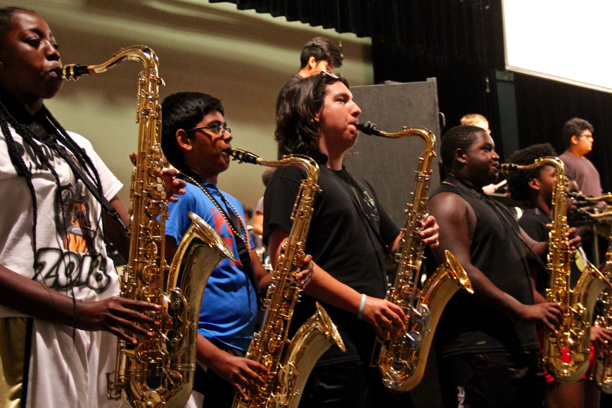 During freshman orientation, the marching band played various songs.