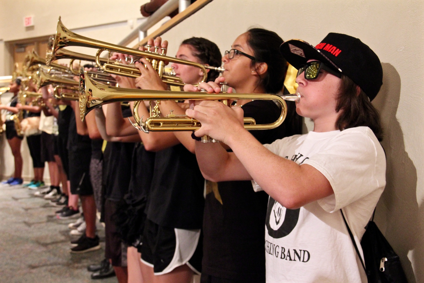 The marching band lined the auditorium walls during the freshman orientation.