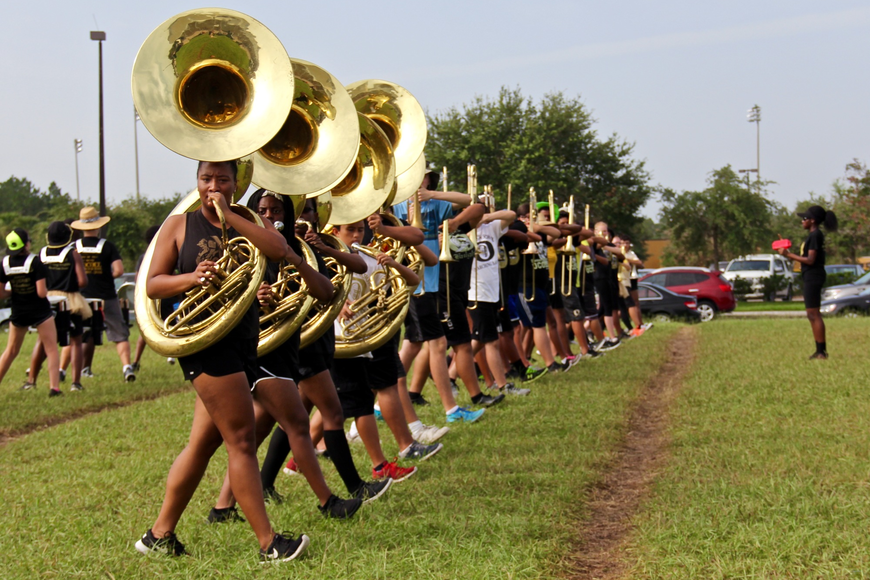 To warm up, band members practiced various marching drills.