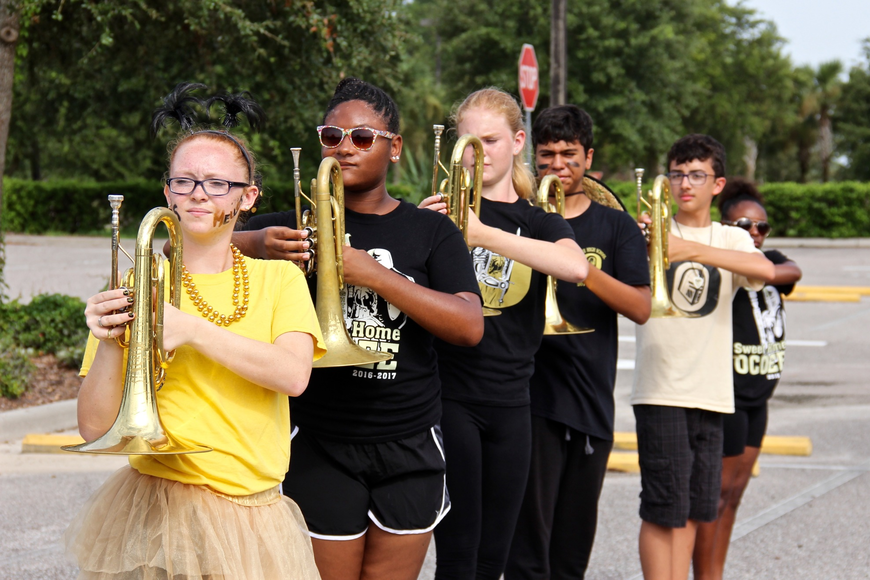 Students practiced their marching techniques in the high school's parking lot.