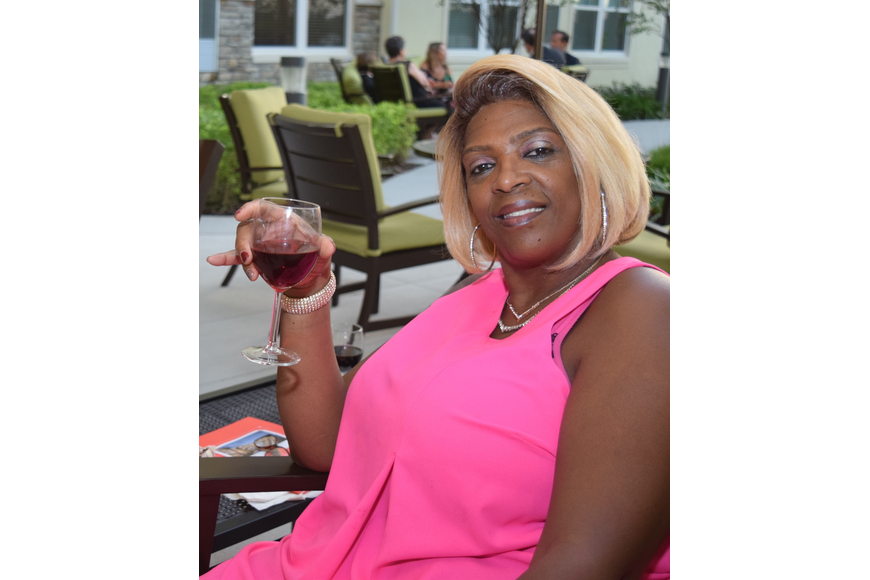 Thelma Jones chatted with friends and enjoyed a glass of wine.