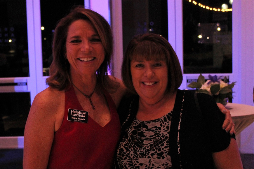 Mary Pando and Debbie Persampiere were happy with the turnout at Helpful Hand's signature event.