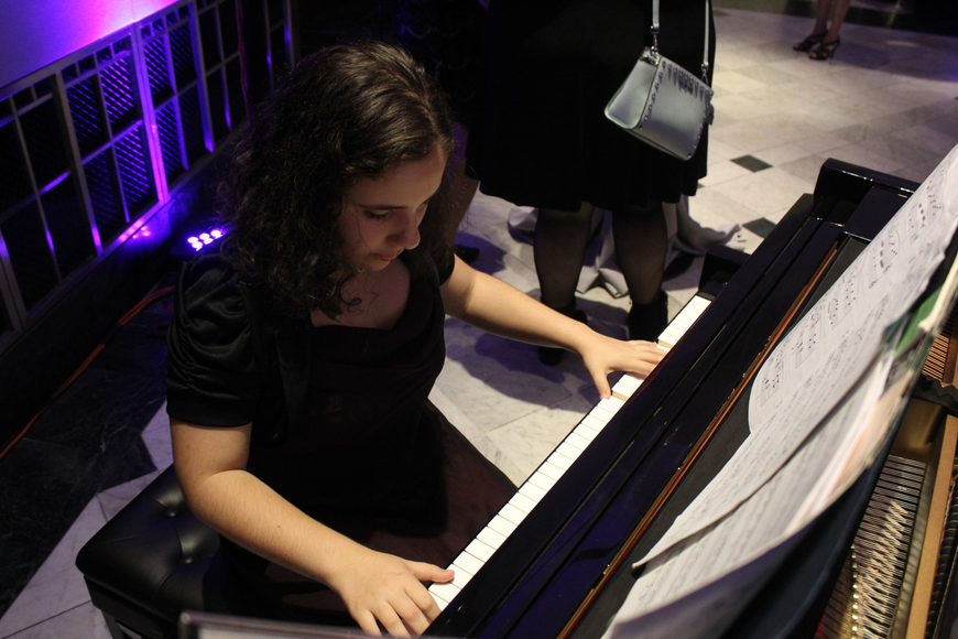 14-year-old Daly Santana played piano for the guests.