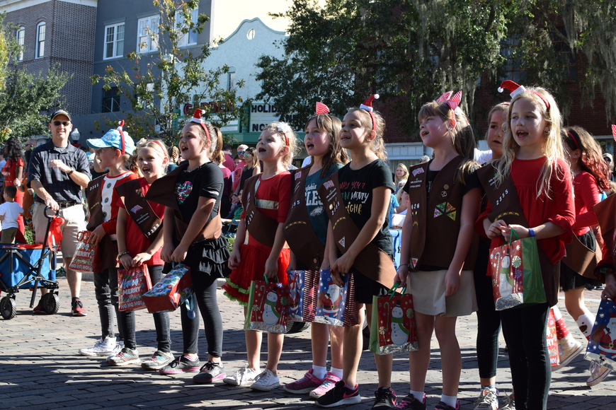 Girl Scouts of Citrus sparked 'awws' from onlookers after singing a short Christmas carol.