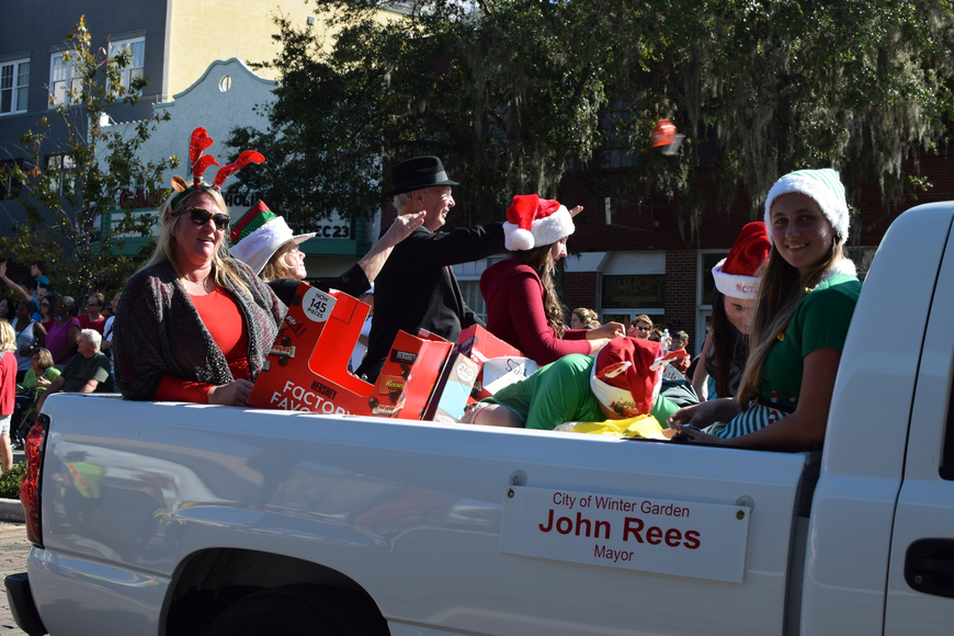 Winter Garden Mayor John Rees and relatives greet the hundreds of parade attendees gathered on Plant Street.