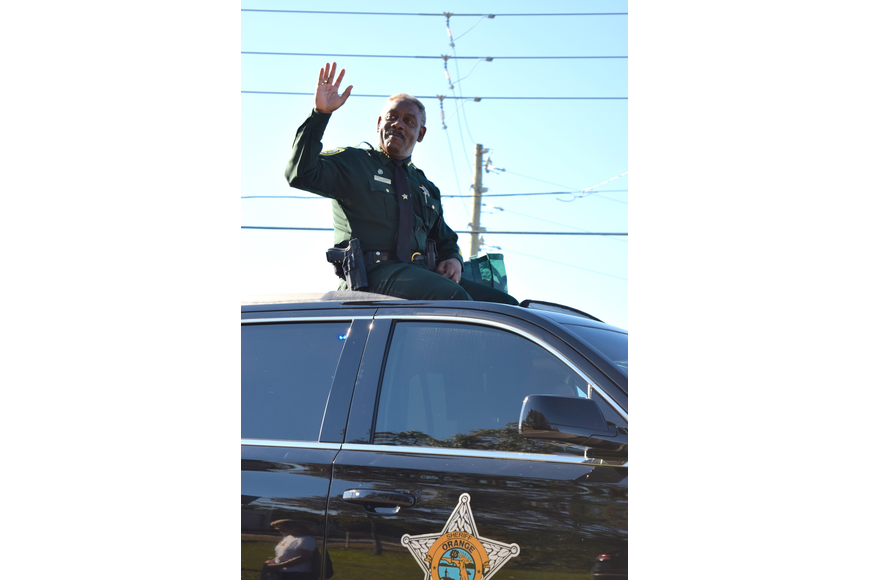 Orange County Sheriff Jerry Demings waved at parade spectators.