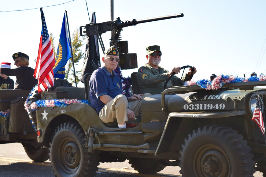 Members of the American Legion Post 109 in Ocoee drove a military vehicle.