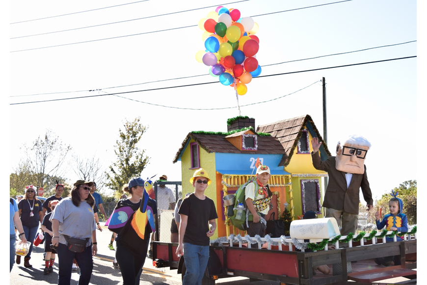 "This ""Up"" themed float was a hit among parade spectators."