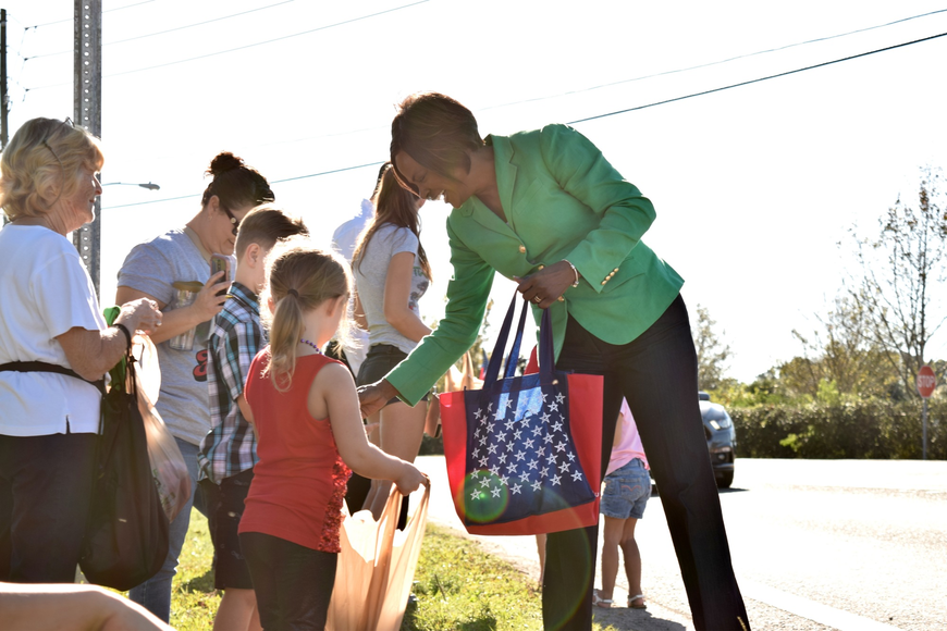 Congresswoman Val Demings handed out candy to kids along the route.