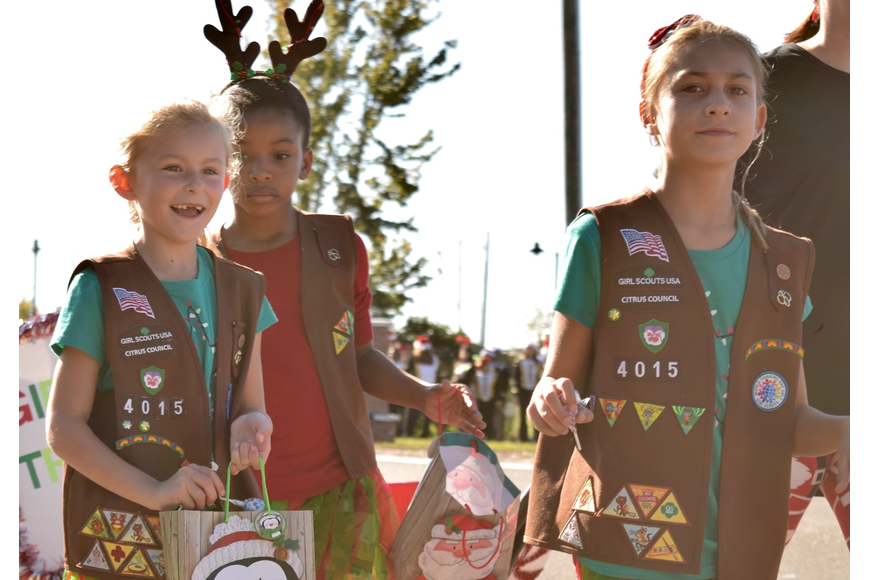 Girl Scout Troop 4015 loved marching and handing out candy to parade spectators.