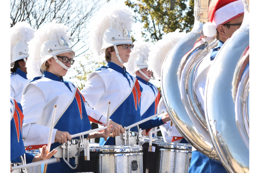 The West Orange High School Marching Band drum line kept the pace.