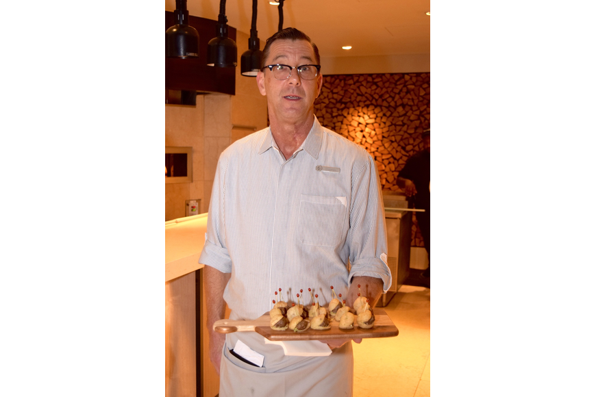 Stephen Gunning holds a platter of hors d'oeuvres.