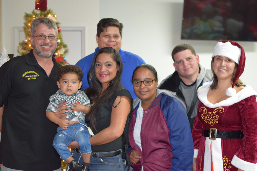 Post Commander Daniel Kalagian (far left) and his wife Priscila with one of the Puerto Rican families who attended the gathering. Pictured: Jessenia and Emil De Jesus, Kevin Nieves, Maria Vazquez and Richard Figueroa.