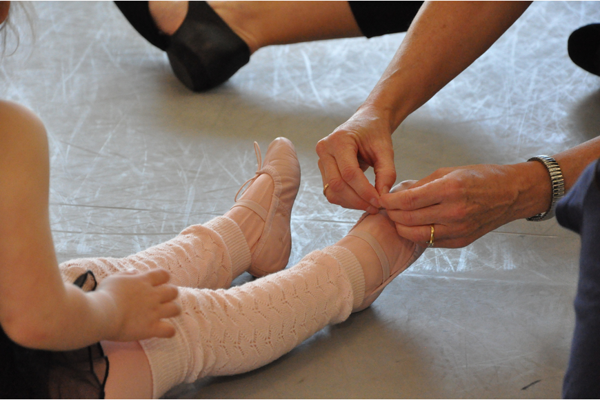 Reese Jo Wilt got some help tying her ballet shoes.