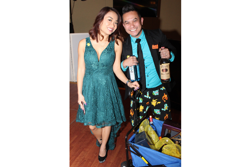 Katie and John Tran were thrilled to win a literal cart of drinks.