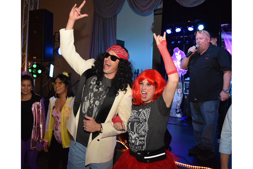 Costumes ranged from neon workout outfits to rocker facades, like this couple put on.
