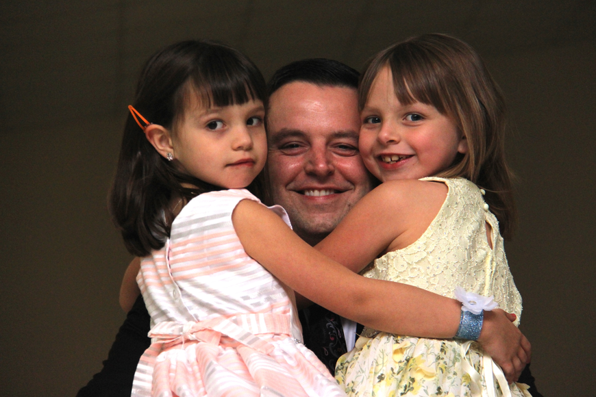 Ross Lumsden held his two daughters Mia, left, and Emma, right, during a slow dance.