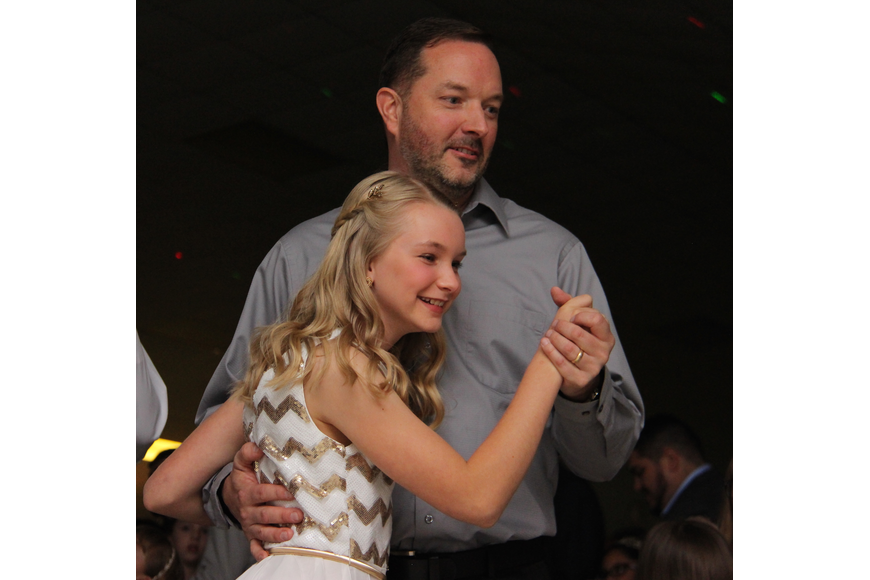 Kiersten Rose and her dad, Doug, joined hands for a slow dance.