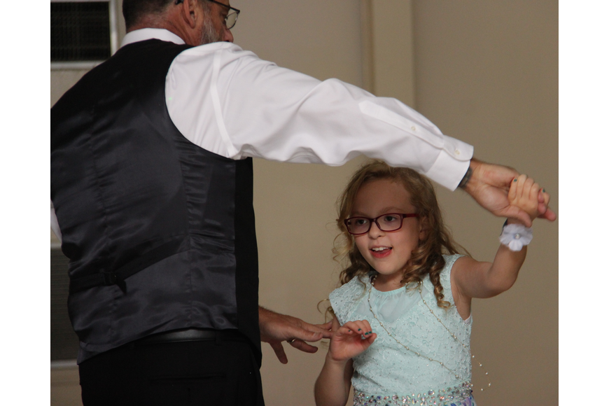 Shawn Doepke swayed and twirled with his daughter, Elena, as they danced.