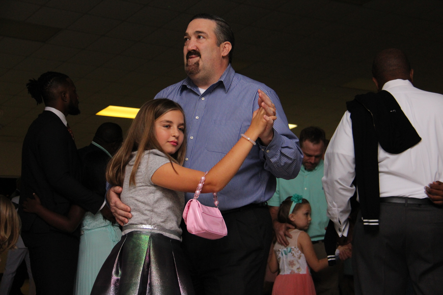 Brian Smith held his daughter, Lauren, close as they slow danced.