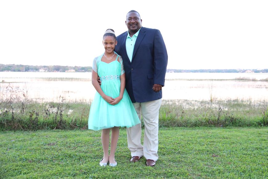Jalissa Smith and her dad, Justin, wore matching colors for the dance.