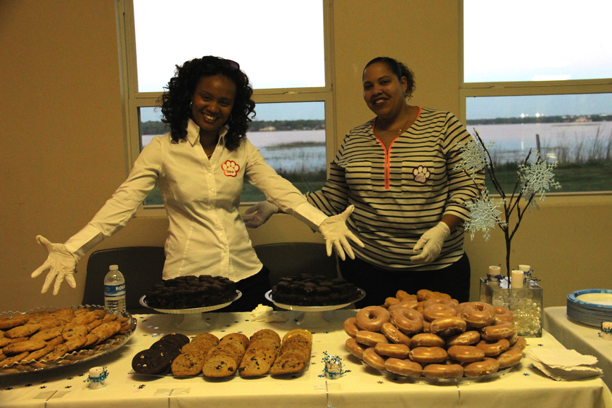 Tara Boddie, left, and Patty Andino had fun serving up sweet treats.