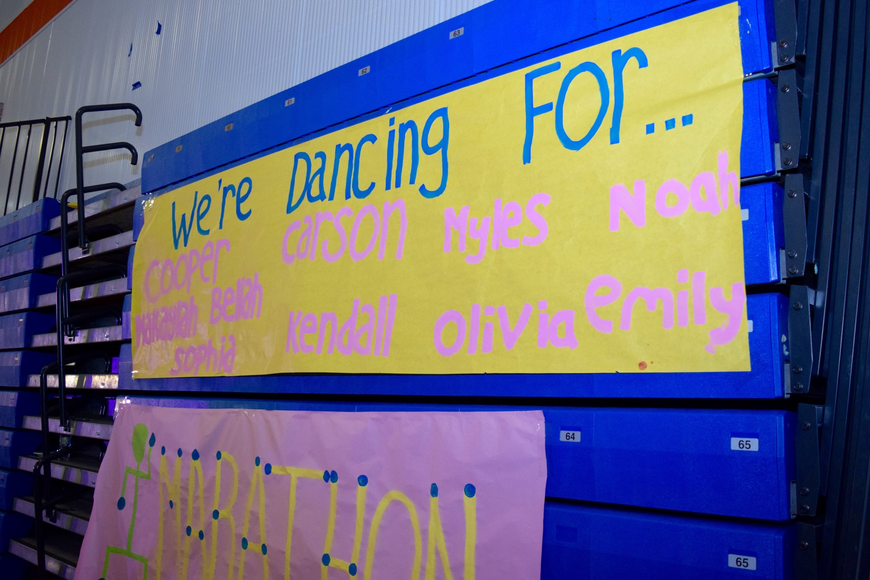 "Names of Warriorthon's ""miracle children"" adorned a poster in the gym."