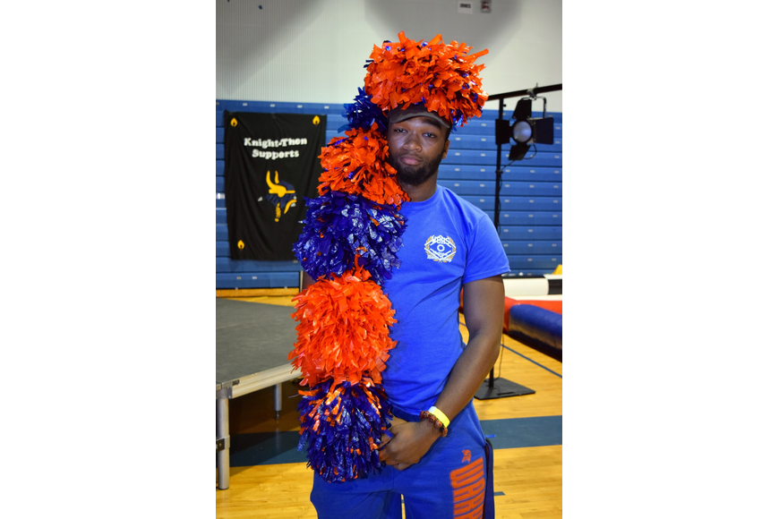 Tre Jackson donned a fluffy, orange-and-blue hat.