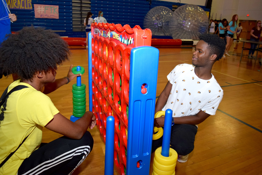 Darren McCoy and Jaedan Jah played a jumbo-sized game of Connect 4.