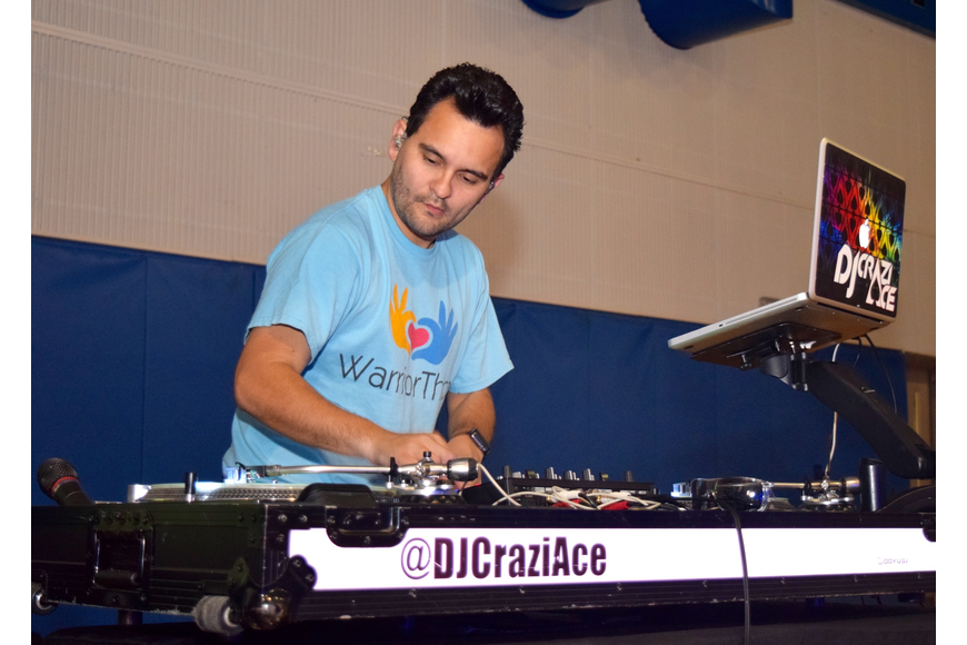 DJ Crazi Ace played the tunes to pump students up and keep them dancing.