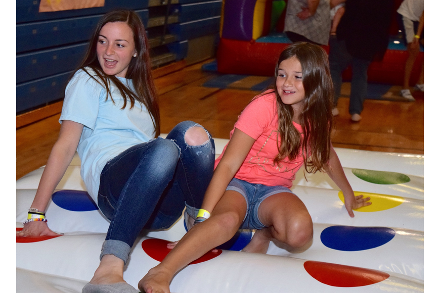 Sisters Taylor Lambert and Kyleigh Reynolds played Twister.