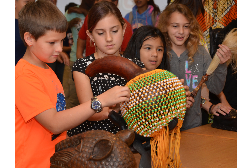 Jason McConnell Jr., Alexa Valentine, Daniella Vargas and Shaylee Kilmartin try out the ancient African instrument.