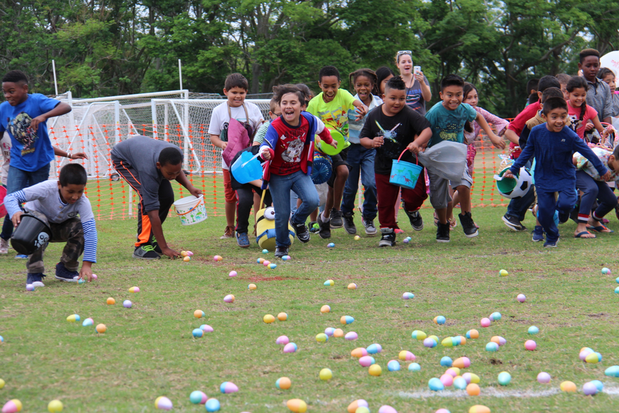 Dozens of children ages seven to nine rushed to the field to fill their baskets with Easter Eggs.