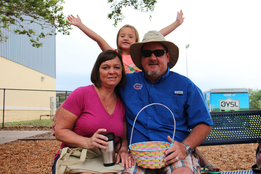 Taylor Walters, middle, was excited to be at the egg hunt with her parents Tara Milano and Phillip Walters.